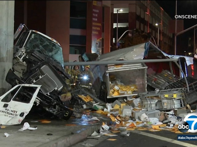1 injured, mail scattered onto roadway after postal truck careens off 110 Freeway in Exposition Park