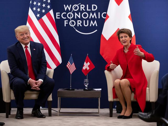 Trump dismisses climate 'prophets of doom' as Greta Thunberg looks on