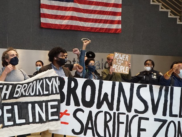 Protesters storm Nat Grid lobby downtown calling for public power