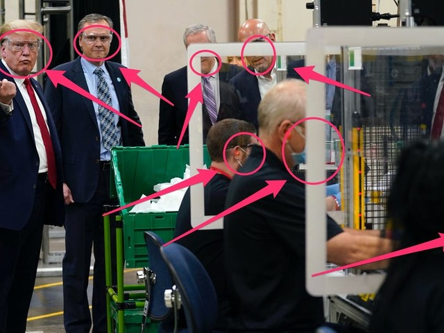 Trump declined to wear a mask at a mask making factory — despite signs displayed that they were required — in a visit that featured music usually played at his campaign rallies