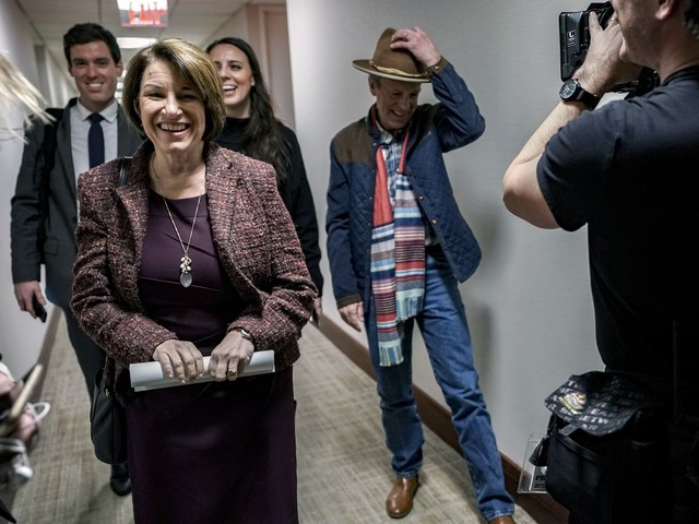 For Amy Klobuchar, the impeachment trial means bombarding Iowa voters from distant D.C.