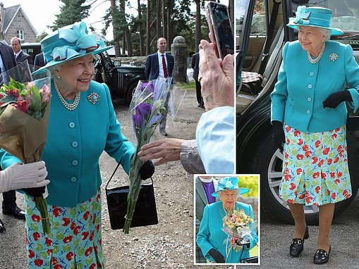 The Queen looks elegant in blue while spending the day at a craft fair in Scotland