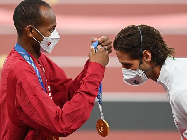18 Heartwarming Photos Of Olympians Embracing New COVID Protocols