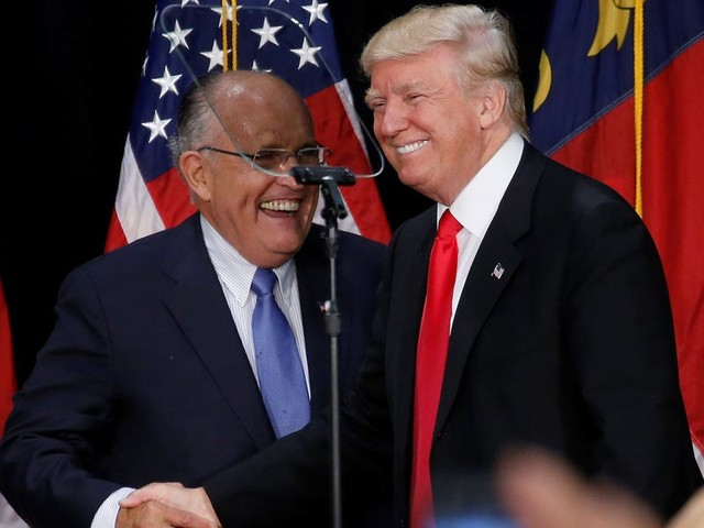 Rudy Giuliani said he has 'insurance' if Trump tries to throw him under the bus in the impeachment process