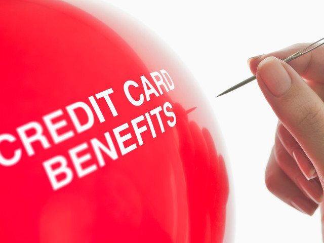 Credit card issuers trimming benefits to cut costs