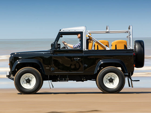 This Stunning Land Rover Defender Is the Ultimate Custom Beach Cruiser