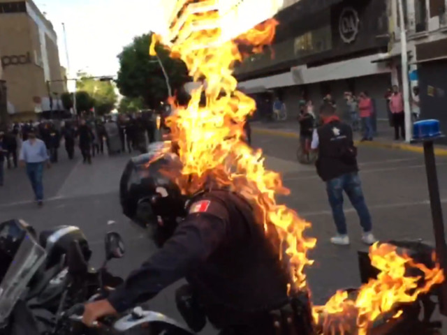 Patrol officer SET ON FIRE during police brutality protests over 'Mexican George Floyd' (VIDEO)