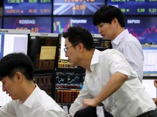 Asian shares mixed on caution over China-US trade deal