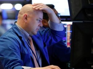 Stocks tumble as virus fears spark sell-off; Dow falls 453