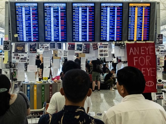 Hong Kong Airport Cancels Flights Amid Protests. How Has Your Travel Been Affected?