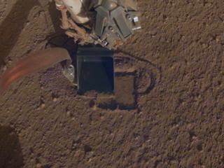 Mars lander's digger is burrowing again after snag