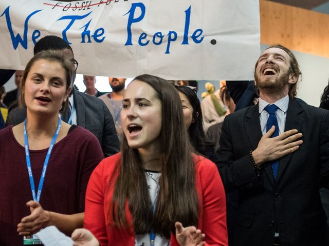 Protesters sing disdain for US climate policy at UN climate talks