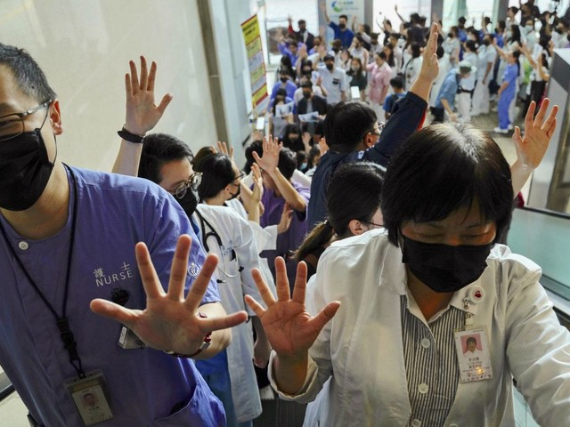 Staff at Hong Kong hospital hold rally in support of protesters