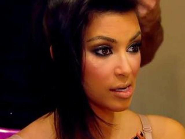 Kim Kardashian HAS to Get Home for Carls Jr. Commercial