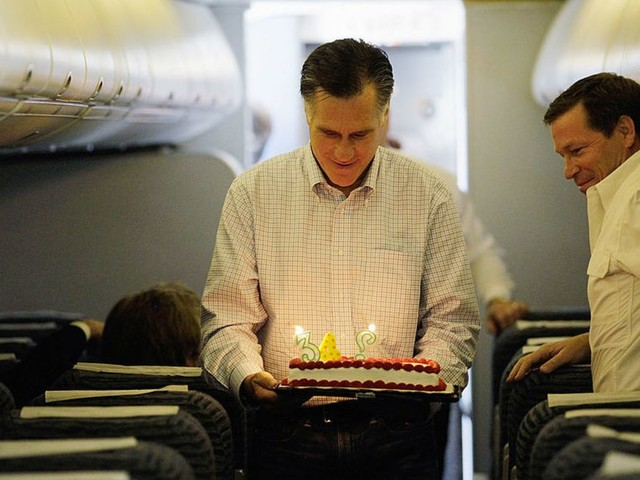Here's Mitt Romney blowing out his birthday candles one by one, just like a real human boy