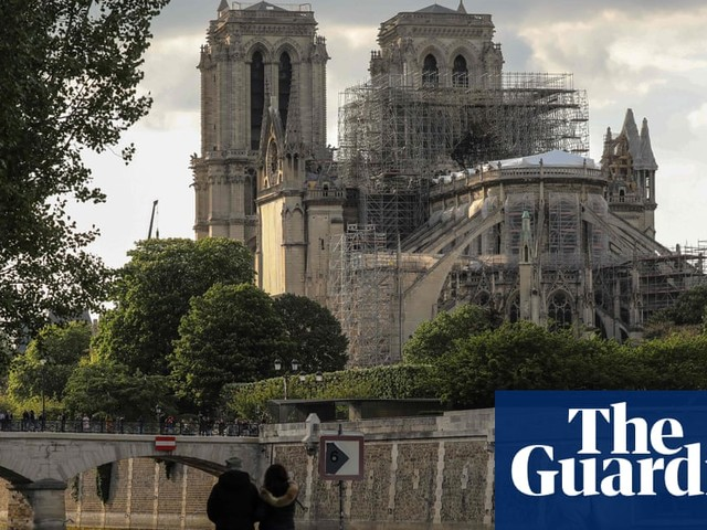 Notre Dame fire: police say air not toxic despite high lead levels on ground