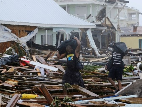 Hurricane Dorian left at least 40 dead and 70,000 homeless in the Bahamas, and recovery efforts have devolved into 'chaos'