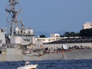 The Latest: US Navy says search continues for 7 sailors