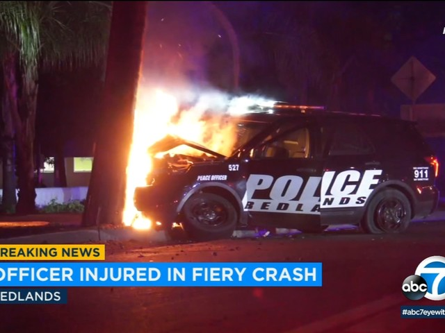 Redlands police officer hospitalized after patrol vehicle slams into power pole, causes outage