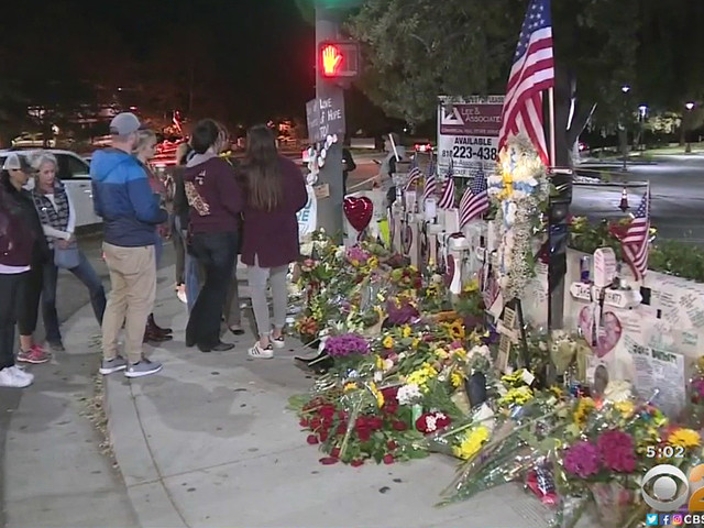 Familiar White Crosses Mark Growing Memorial In Front Of Borderline Bar & Grill