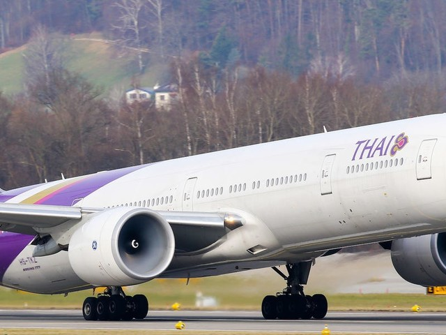 A Thai Airways plane was forced to abort its takeoff after an 'explosion' that left a huge hole in one of its engines