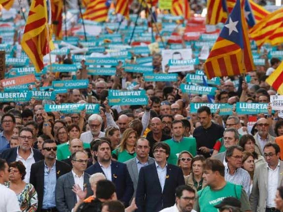 "Catalan President Slams ""Spanish State Coup"" As 450,000 Take To Barcelona's Streets"