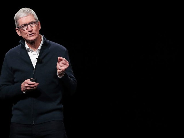 Apple CEO Tim Cook says there's a 'false tradeoff' between technological progress and forcing people to give up their personal data (AAPL)