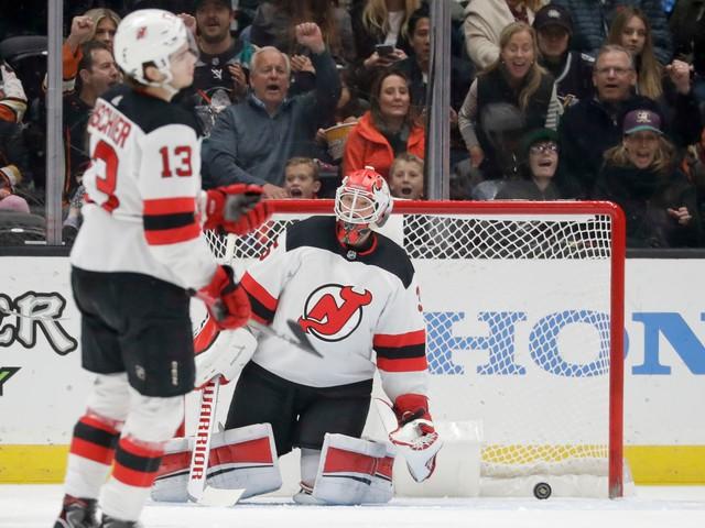 Devils score 3 own goals en route to shootout loss to Ducks