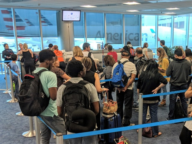 Be careful what you bid: American will now pay volunteers different amounts on oversold flights