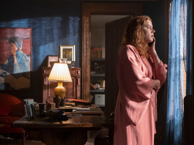 Amy Adams spies a convoluted Rear Window mystery in The Woman In The Window