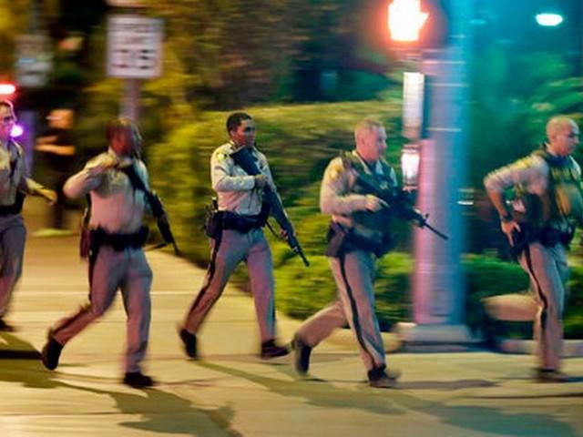 Videos show Vegas police helping people duck, escape gunfire