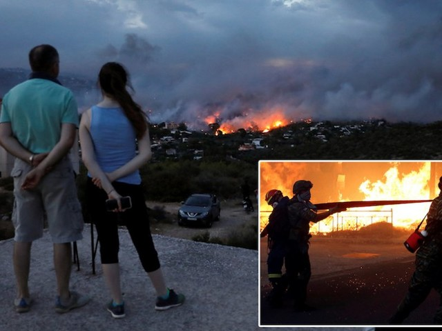 Devastating wildfires in Greece kill 81 while dozens stranded on the beach watched their homes burn