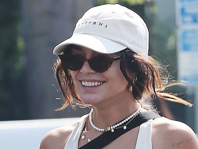 Vanessa Hudgens Elevates Sweats With an Edgy Leather Jacket & the Chunkiest Orange Sneakers