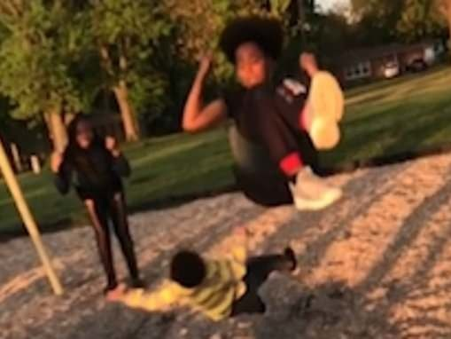 Illinois toddler narrowly escapes being hit by girl on a swing - but turns back and is knocked over