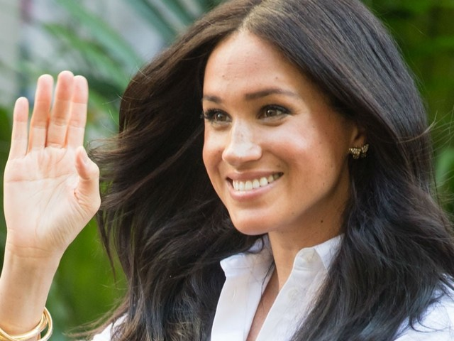 Meghan Markle Is All Smiles As She Drives to Pick Up Her Friend at the Airport