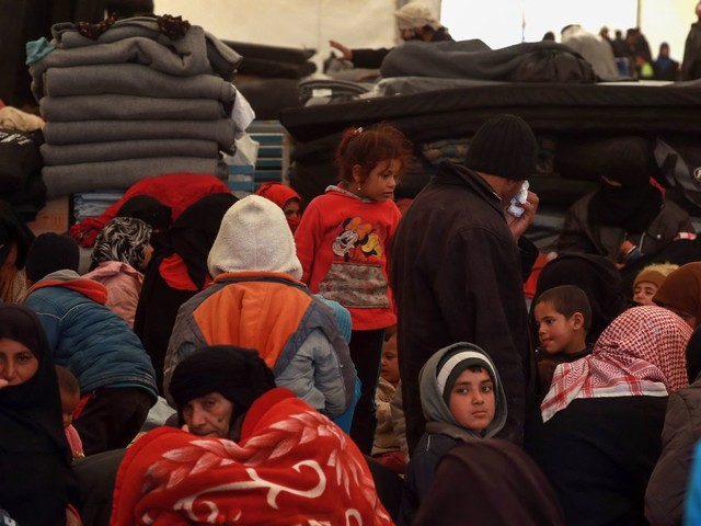 'We Were Eating Grass': Syrians Flee As Fight Pushes On Against Last ISIS Remnants