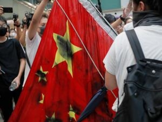 Hong Kong protesters trample Chinese flag, set fires
