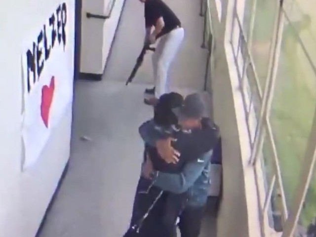 Shocking video shows moment HS coach disarms student with shotgun — and embraces him with bear hug