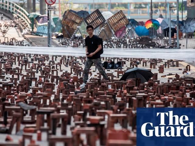 Hong Kong's brick barricades and snow in Lyon: Friday's top photos