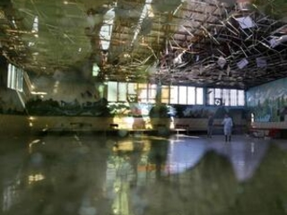 Afghan officials: Suicide attack at wedding hall kills 63