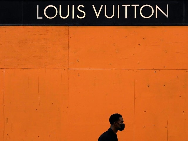Louis Vuitton is painting boarded up windows its signature orange shade, revealing a dystopian new reality prior to a historic election
