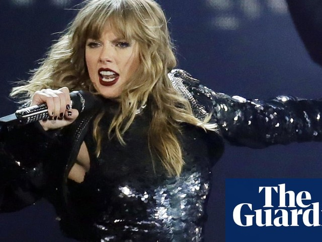 Taylor Swift says she's being banned from singing her old hits at AMAs