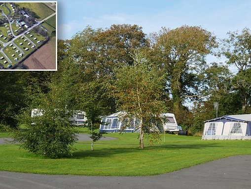 Motorist charged after a car smashed into tents on a Welsh campsite