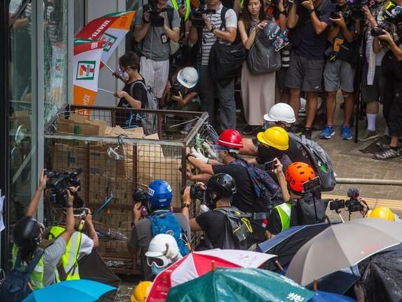 Hong Kong Protests Re-Ignite - 1000s Storm Legislature, Cops Unleash Pepper Spray
