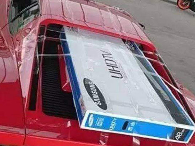 Carry A Big TV With A Ferrari Testarossa? Why, There's A Whole Lotta Space Above The Engine