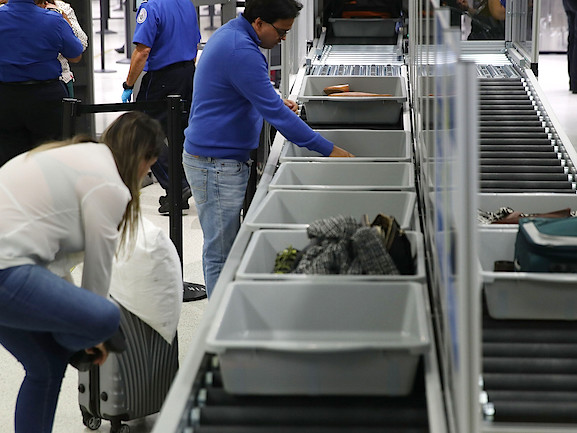 Study: Airport Security Trays Carry More Germs Than Toilets