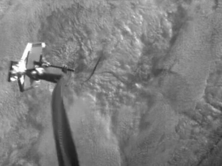 Watch a satellite spear space debris with a harpoon