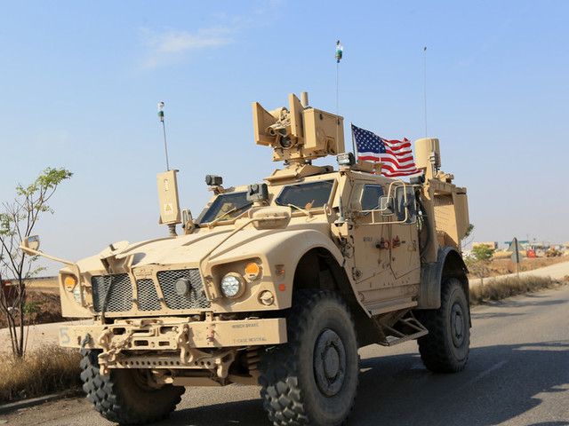 Just going next door: More than 100 armored vehicles cross into Iraq as US troops withdraw from northern Syria