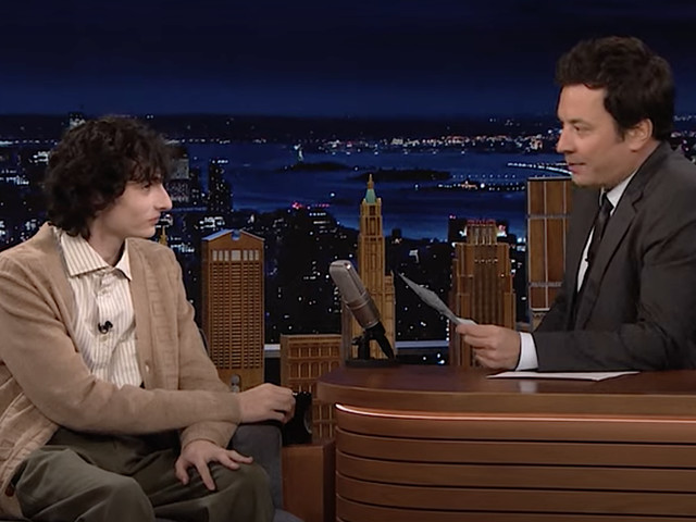Finn Wolfhard practices his poker face while Jimmy Fallon asks about Stranger Things rumors