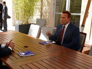 Schwarzenegger talks climate change with French president